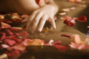 Woman bathing with flower petals